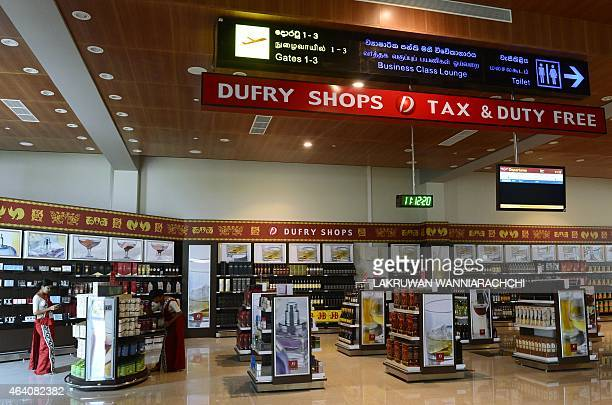 SriLankaeconomyinfrastructureFOCUS by Amal Jayasinghe In this photograph taken on February 10 Sri Lankan workers look at displays in the duty free...