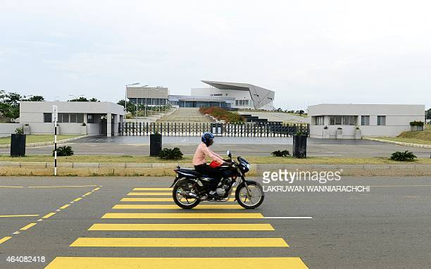 SriLankaeconomyinfrastructureFOCUS by Amal Jayasinghe In this photograph taken on February 10 a Sri Lankan motorcyclist rides past the entrance to...