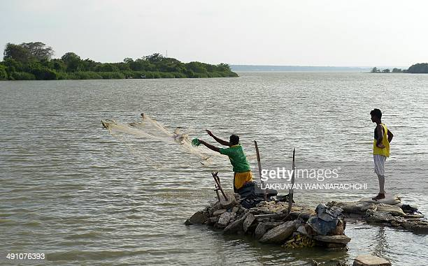 SriLankamilitaryconflictFOCUS In this photograph taken on May 13 Sri Lankan fishermen cast their nets in the Nanthi Kadal lagoon in the area where...