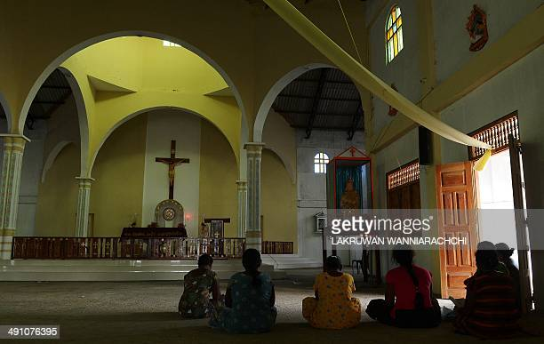 SriLankamilitaryconflictFOCUS In this photograph taken on May 13 Sri Lankan devotees offer prayers at a church in the area where the body of Tamil...