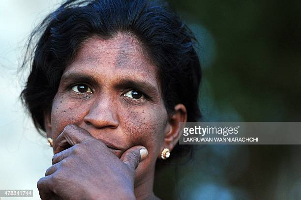 SriLankawarwidows FEATURE by Amal Jayasinghe In this photograph taken on June 9 Sri Lankan war widow Evin Selvy listens to a question from an AFP...