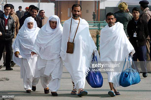 A group of pilgrims walks to the Jeddahbound flight at Srinagar's airport 06 December 2005 on their way to perform Hajj About ten thousand Muslims...