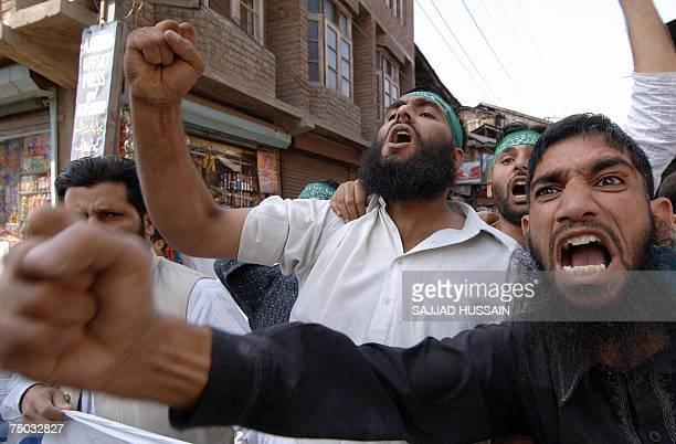 In this picture taken 15 September 2006 Indian Kashmiri Muslim Shakeel Bhat joins Indian Kashmiri activists of the proPakistani Muslim League Jammu...