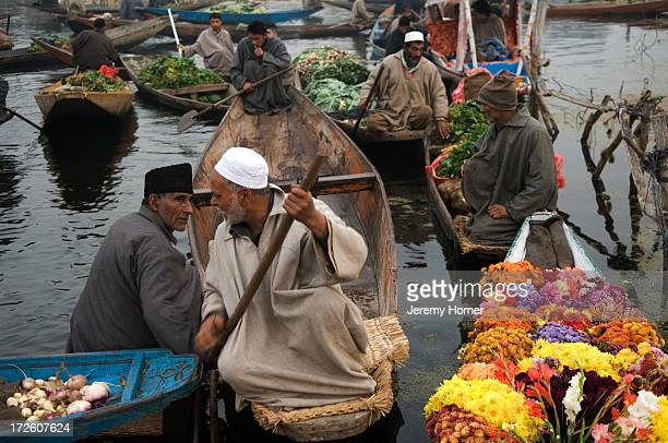 SRINAGAR JAMMU KASHMIR INDIA Srinagar's floating market congregates where the canals that feed into Dal Lake meet It begins before sunrise and...