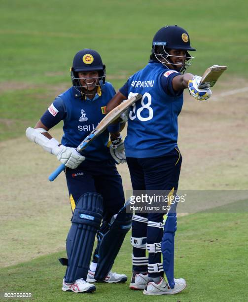 Sripali Weerakkody of Sri Lanka points to the back of Chamari Atapattu as Chamari Atapattu celebrates her 150 during the ICC Women's World Cup 2017...