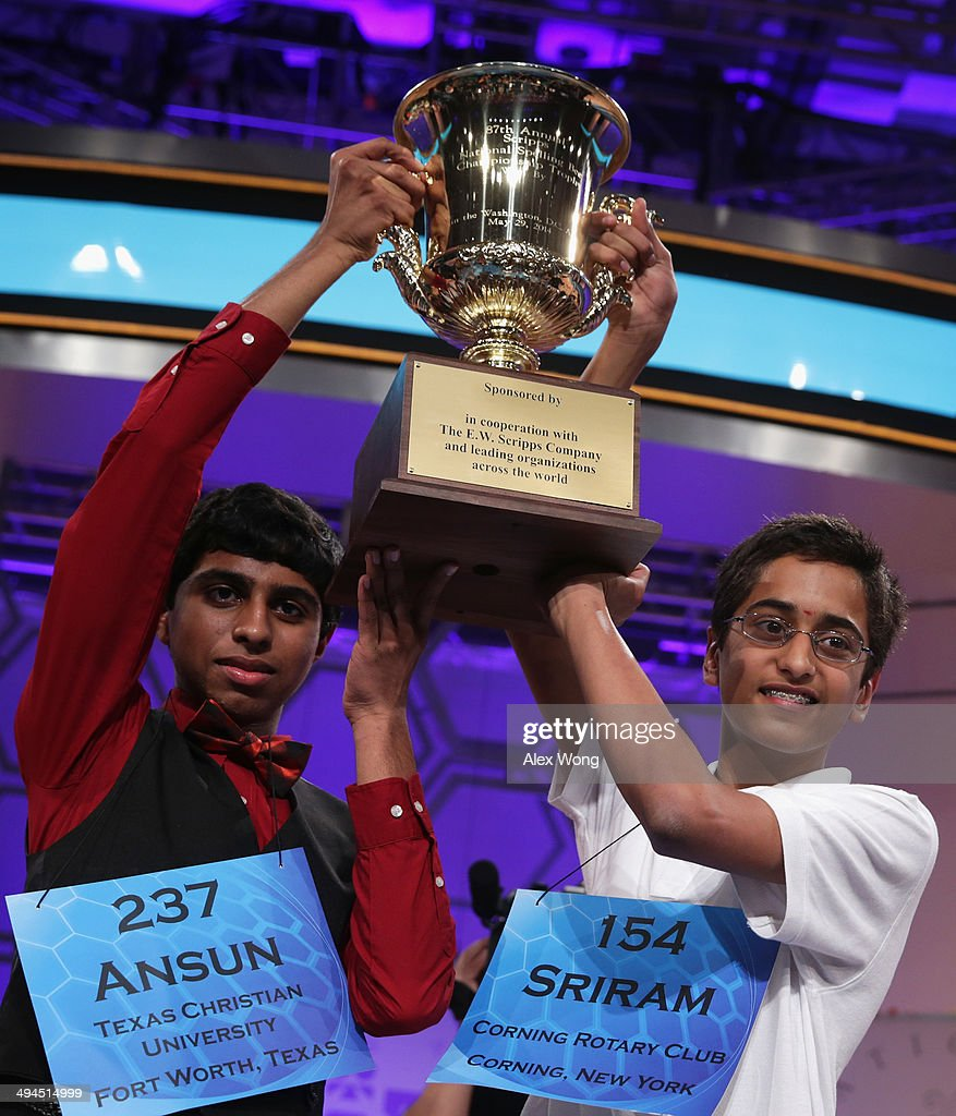 Sriram Hathwar (R) of Painted Post, New York and Ansun Sujoe (L) of Fort Worth, Texas hold their trophy at the end of the 2014 Scripps National Spelling Bee competition May 29, 2014 in National Harbor, Maryland. Hathwar and Sujoe were declared as co-champions after 22 rounds of the competition.