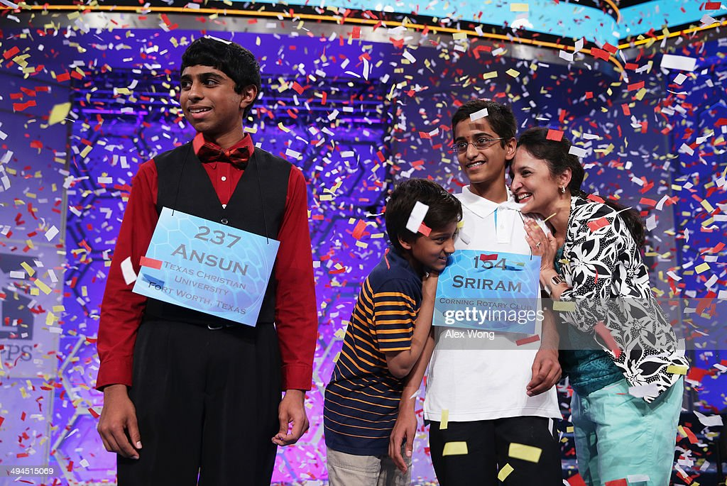 Sriram Hathwar (R) of Painted Post, New York is greeted by family members after he and Ansun Sujoe (L) of Fort Worth, Texas both won the 2014 Scripps National Spelling Bee competition May 29, 2014 in National Harbor, Maryland. Hathwar and Sujoe were declared as co-champions after 22 rounds of the competition.