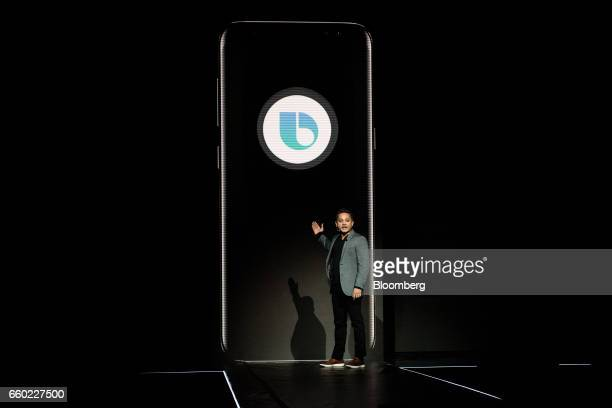 Sriram Thodla senior director of services and new business for Samsung Electronics Co unveils the new Bixby AI assistant during the Samsung Unpacked...