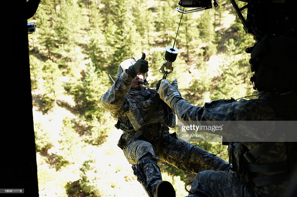 S/sgt Jose Pantoja ready to ride the rescue hoist down from a UH-60 Black Hawk to retrieve two stranded ladies near Jamestown during search and rescue flight with members of the 2-4 GSAB with the 4th ID of Fort Carson September 17, 2013 Boulder, CO.