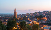 Cork, Ireland - July 19, 2013: St. Anne's in Shandon and the City of Cork photographed against a beautiful sunset at dusk.