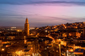 Cork, Ireland - April 14, 2014: St. Anne's in Shandon and the City of Cork photographed against a beautiful sunset at dusk.