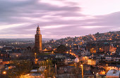 Cork, Ireland - April 12, 2014: St. Anne's in Shandon and the City of Cork photographed against a beautiful sunset at dusk.