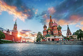 St. Basil's Cathedral and the Spasskaya Tower of the Moscow Kremlin and the summer sunset with colorful clouds