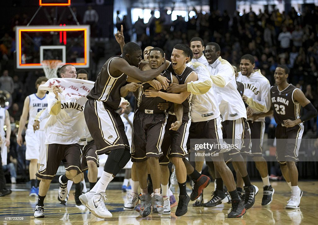 St Bonaventure Bonnies team pile on guard Jordan Gathers who hit the game winning shot against the St Louis Billikens in the Quarterfinals of the...