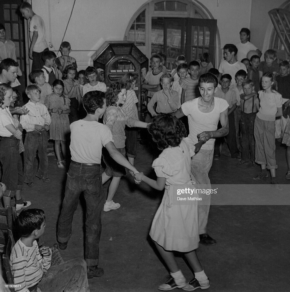 AUG 18 1947 St Charles Community Center An Enthusiastic young class in square dancing goes through the traditional pioneer dance at the St Charles...