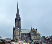 St. Colman's Cathedral sits atop Cobh, Ireland, overlooking the harbor town. Construction began in 1867 and took nearly a 50 years to complete because of costs and revisions. The cathedral contains th