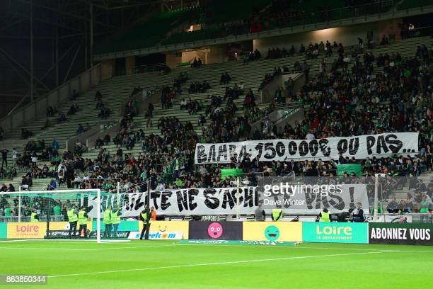 St Etienne fans hold up a banner admonishing their player Jonathan Bamba for refusing to sign a new contract during the Ligue 1 match between AS...