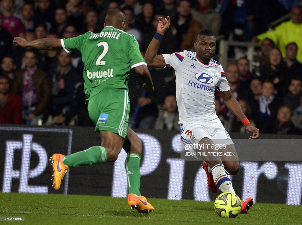 St Etienne's French defender Kevin Theophile-Catherine (L) vies with Lyon's French Cameroonian defender <a gi-track='captionPersonalityLinkClicked' href=/galleries/search?phrase=Henri+Bedimo&family=editorial&specificpeople=2293105 ng-click='$event.stopPropagation()'>Henri Bedimo</a> (R) during the French L1 football match between Lyon and Saint-Etienne on April 19, 2015, at the Gerland stadium in Lyon, southeastern France.
