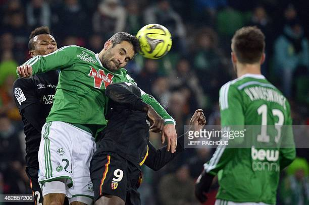 St Etienne's French defender Loic Perrin vies for the ball with Lens' French forward Adamo Coulibaly and Lens' French defender JeanPhilippe Gbamin...