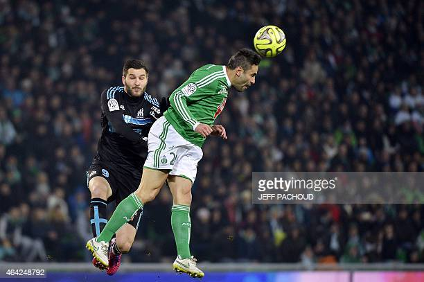 St Etienne's French defender Loic Perrin vies with Marseille's French forward AndrePierre Gignac during the French L1 football match AS SaintEtienne...