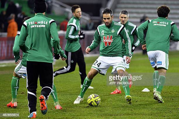 St Etienne's French defender Loic Perrin warms up prior to the French L1 football match AS SaintEtienne vs Racing Club Lens on February 6 at the...