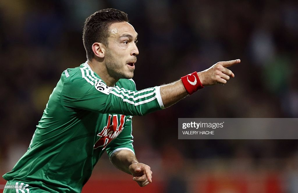 St Etienne's French forward Mevlut Erding celebrates after scoring a goal during the French L1 football match Monaco and Saint Etienne on April 3, 2015 at the Louis II Stadium in Monaco. AFP PHOTO / VALERY HACHE