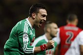 St Etienne's French forward Mevlut Erding celebrates after scoring a goal during the French L1 football match Monaco and Saint Etienne on April 3...