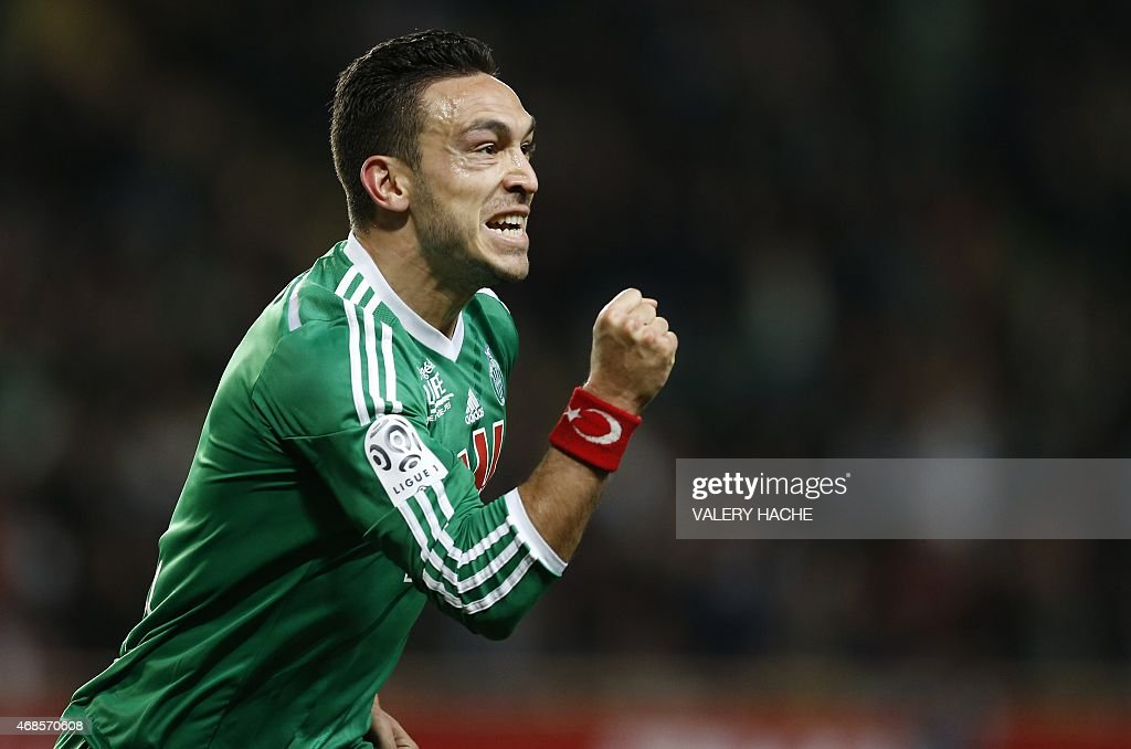 St Etienne's French forward Mevlut Erding celebrates after scoring a goal during the French L1 football match Monaco (ASM) vs Saint Etienne (ASSE) on April 3, 2015 at the 'Louis II Stadium' in Monaco. AFP PHOTO / VALERY HACHE