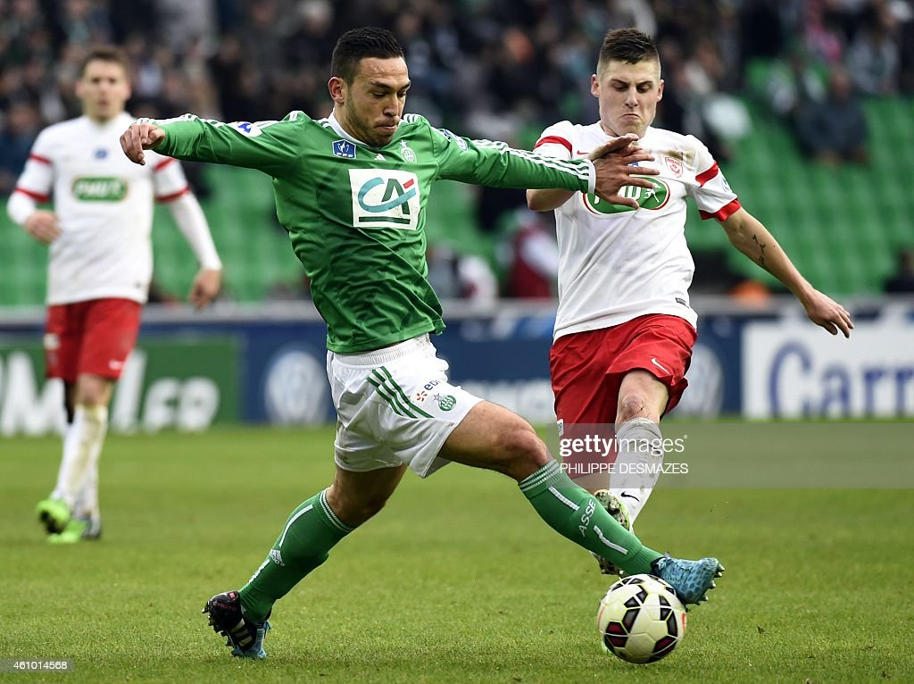 St Etienne's French forward Mevlut Erding vies for the ball with Nancy's French defender Clement Lenglet during the French Cup round of 64 football...