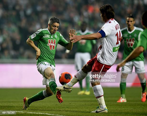 St Etienne's French midfielder Fabien Lemoine vies with Ajaccio's French and Algerian midfielder Mehdi Mostefa during the French L1 football match...