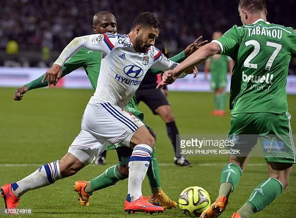 St Etienne's French midfielder Joel Tsafack Nguemo and St Etienne's French midfielder Franck Tabanou vies with Lyon's French midfielder Nabil Fekir...