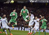 St Etienne's French midifielder Benjamin Corgnet and St Etienne's French defender Loic Perrin vies Lyon's French forward Alexandre Lacazette during...