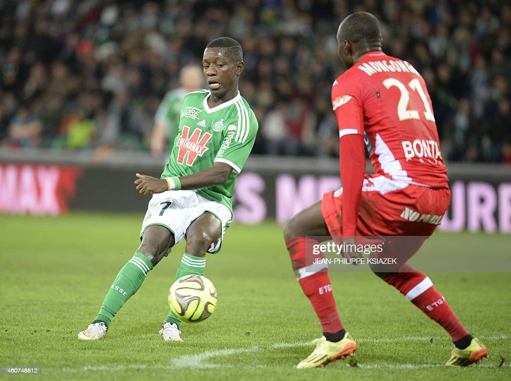 St Etienne's Ivorian forward Max-Alain Gradel (R) vies with Evian's Congolese defender <a gi-track='captionPersonalityLinkClicked' href=/galleries/search?phrase=Cedric+Mongongu&family=editorial&specificpeople=4305033 ng-click='$event.stopPropagation()'>Cedric Mongongu</a> during the French L1 football match AS Saint-Etienne (ASSE) vs Evian (ETGFC) on December 21, 2014, at the Geoffroy-Guichard stadium in Saint-Etienne, central France. AFP PHOTO / JEAN-PHILIPPE KSIAZEK