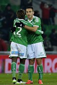 St Etienne's Turkish forward Mevlut Erding celebrates with a teammate after scoring a goal during the French L1 football match AS SaintEtienne vs...
