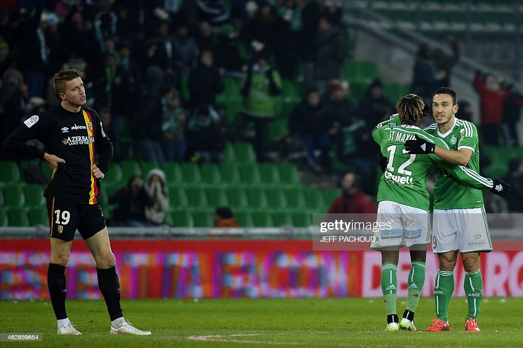 St Etienne's Turkish forward Mevlut Erding (R) celebrates with his teamate after scoring a goal during the French L1 football match AS Saint-Etienne (ASSE) vs Racing Club Lens (RCL) on February 6, 2015, at the Geoffroy Guichard Stadium in Saint-Etienne, central France. AFP PHOTO / JEFF PACHOUD