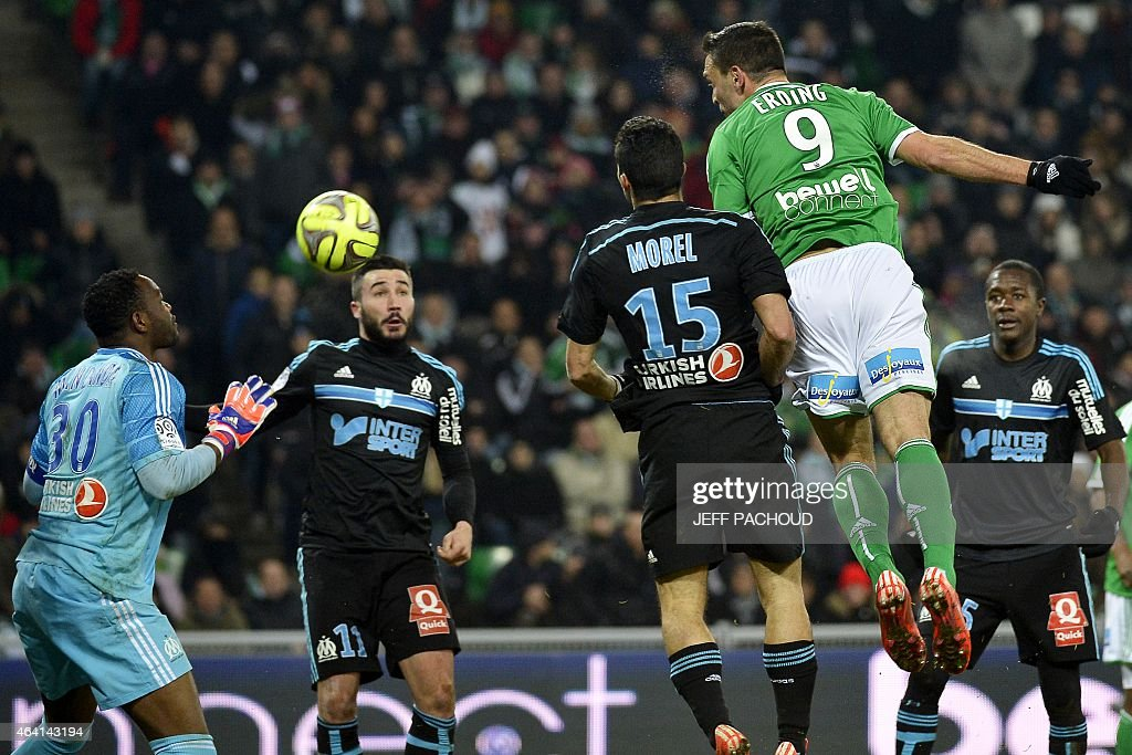 St Etienne's Turkish forward Mevlut Erding (R) scores a goal during the French L1 football match AS Saint-Etienne (ASSE) vs Olympique de Marseille (OM) on February 22, 2015, at the Geoffroy Guichard Stadium in Saint-Etienne, central France. AFP PHOTO / JEFF PACHOUD