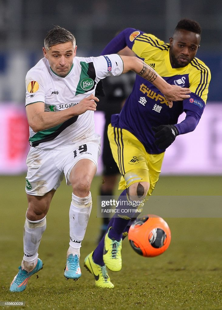 St Gallen's Luxembourger midfielder Mario Mutsch (L) vies for the ball against Swansea City's Ivorian-born Belgian striker Roland Lamah at the end of the Europa League Group A football match between FC St Gallen and Swansea City on December 12, 2013 at the AFG Arena in St Gallen. Swansea lost 1-0.