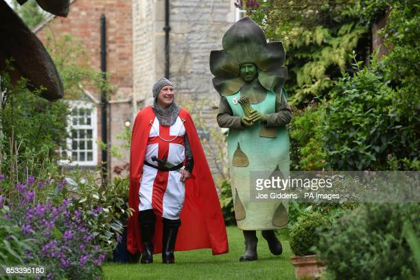 St George and Gus the Asparagus Man celebrate the start of the Asparagus season in Bretforton Worcestershire