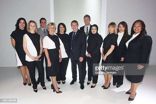 St George bank employees pose on the runway in their new uniforms designed by Camilla and Marc following the St George presents Camilla and Marc...