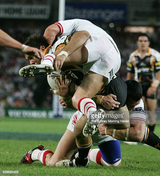 St GeorgeIllawarra's John Skandalis is tackled by the West Tigers' defence during an NRL match 24 September 2005 SMH SPORT Picture by TIM CLAYTON
