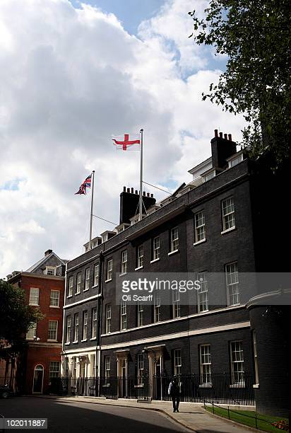 St George's Cross flag flies over Number 10 Downing Street hours before England begin their first game of the FIFA World Cup in South Africa on June...