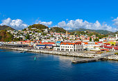 St George's cruise harbor, capital of Grenada, the Caribbean. Waterfront view with beautiful and idyllic town. Panoramic view with bright and colorful colors.