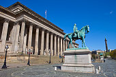 A view taking in the sights of St. George's Hall, the Prince Albert Statue, the Queen Victoria Statue, Liverpool Cenotaph, County Sessions House and Wellington's Column.