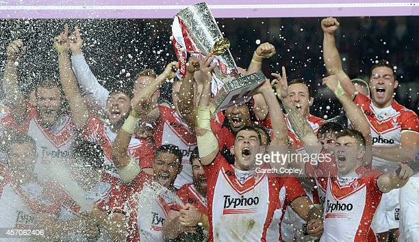 St Helens captain Paul Wellens lifts the trophy after winning the First Utility Super League Grand Final between St Helens and Wigan Warriors at Old...