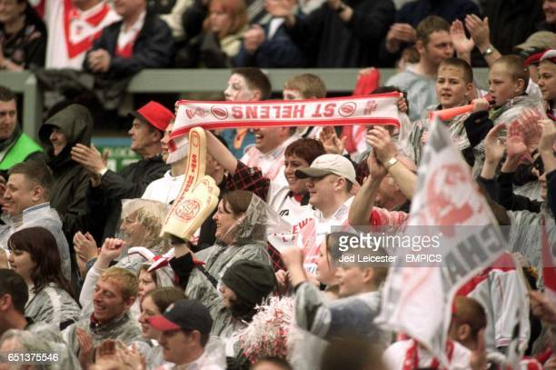 St Helens fans celebrate winning the Silk Cut Challenge Cup in the pouring rain