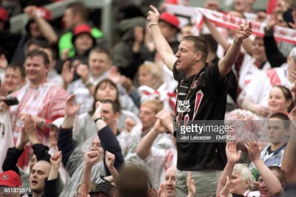 St Helens fans celebrate winning the Silk Cut Challenge Cup