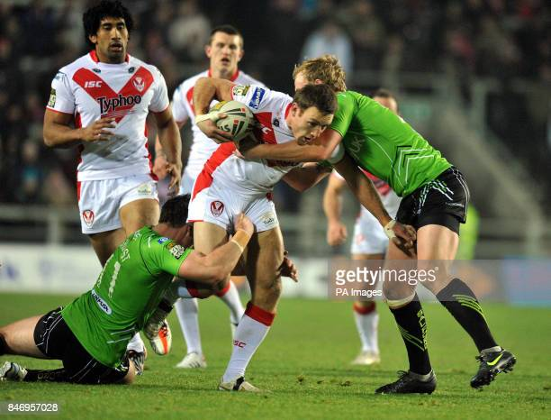St Helens' James Roby is tackled by Salford City Reds' Matty Ashurst and Stuart Howarth during a Stobart Super League match at Langtree Park St Helens