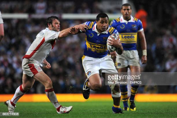 St Helens' Keiron Cunningham attempts to tackle Leeds Rhinos' Ali Lauitiiti