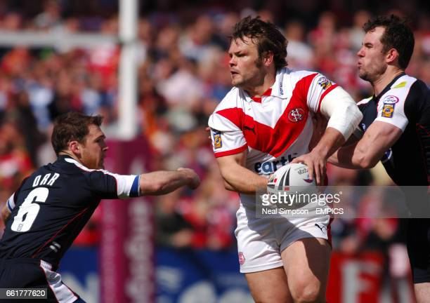 St Helens' Keiron Cunningham gets between Wigan Warriors' Danny Orr and Pat Richards to set up another attack