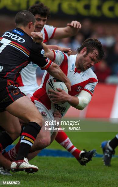 St Helens Keiron Cunningham is stopped by Bradford Bulls Michael Withers